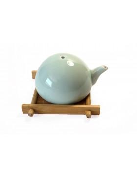 Dosificador de agua tradicional de color turquesa para tintero
