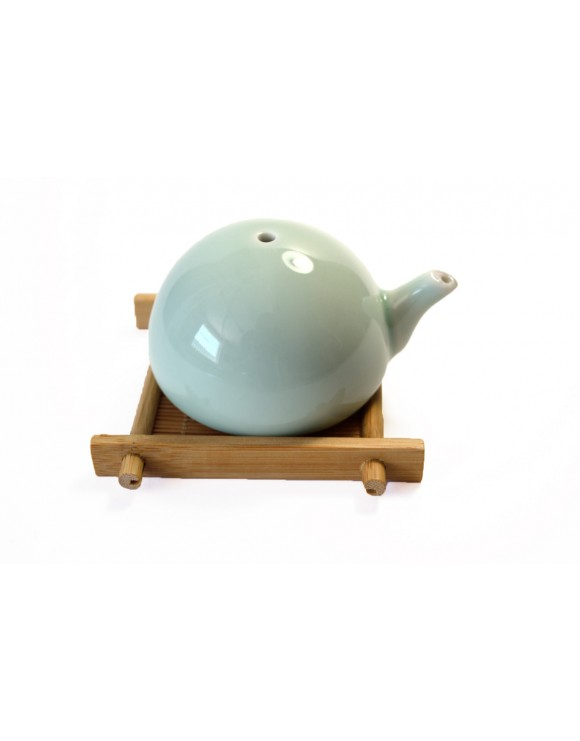Traditional turquoise coloured water dispenser for inkwell