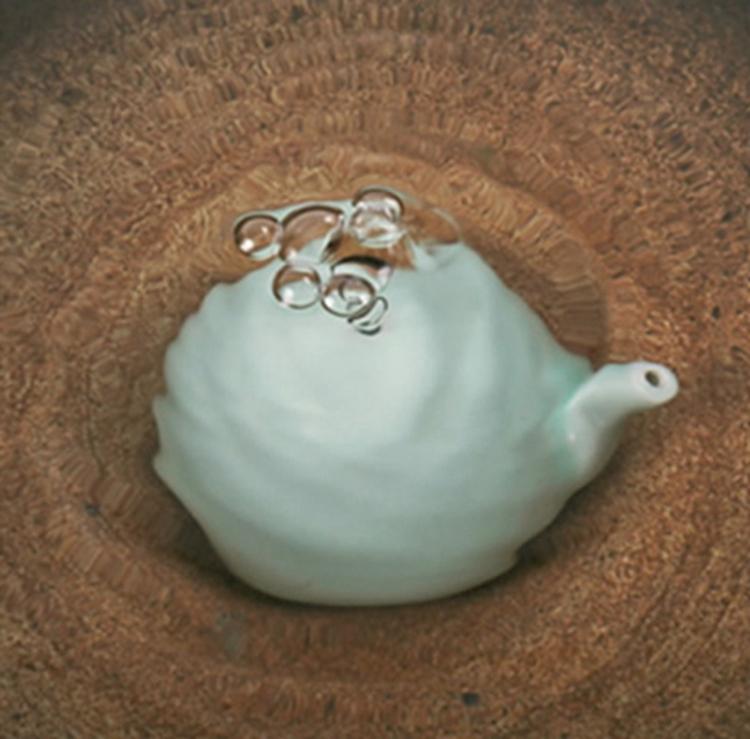 Dosificador de agua tradicional de color turquesa para tintero 02
